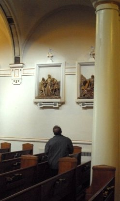 praying at the stations of the cross